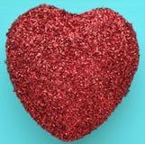 Ett rött blänker hjärta Arkivfoto