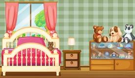 Ett rent sovrum med många leksaker Arkivbilder