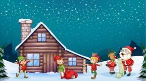 Ett Santa Claus, ungar och en ren Arkivbild
