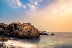 Ett slätt seascapesolnedgångljus Royaltyfri Bild