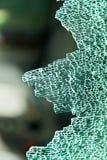 Ett splittrat exponeringsglas förser med rutor i bilen Royaltyfri Bild