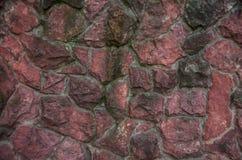 Ett staket av härliga, stora kulöra stenar royaltyfria bilder
