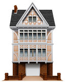 Ett stort konkret hus med ett fäst garage Fotografering för Bildbyråer