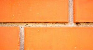 Ett stycke av tegelstenväggen Arkivfoton