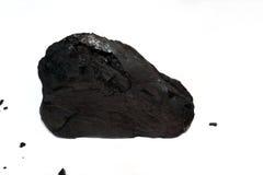 Ett stycke av Under-bituminöst kol på vit Royaltyfri Foto