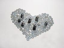 Ett symbol av förälskelse (hjärta) som göras av plana packningar royaltyfri fotografi