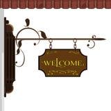 Ett tecken som säger välkomnande Arkivfoto