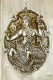 Ett thailändskt felikt lättnadskonstarbete i sepiasignal Arkivfoton