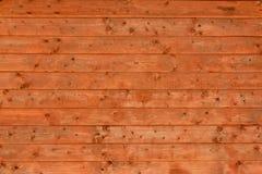 Ett träbräde med horisontallinjer och målad härlig textur och bakgrund arkivfoton