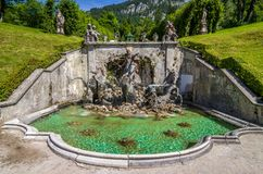 Ettal, Germany, 14 August 2017: Cascade with Neptune fountain in Linderhof Park, Bavaria, Germany royalty free stock photography