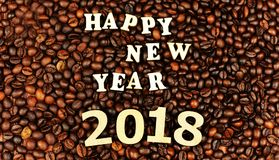 Etters and numbers, inscription happy new year 2018 on fragrant. Letters and numbers, inscription happy new year 2018 on fragrant coffee beans, background of Royalty Free Stock Photography