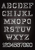 Etters y números en estilo sucio en textura Foto de archivo libre de regalías