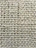 Ettfärgat ohyfsat hänga löst material Arkivbild
