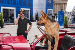 Ettore Bassi and Commissioner Rex. Rome, Italy - May 20, 2011: The actor Ettore Bassi posing together at the German shepherd Nick, both protagonists of the royalty free stock images