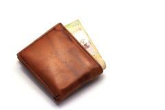 Etwas Geld in der braunen Geldbörse Stockbild