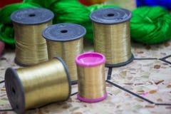 Etwas goldene Jamdani-Sari-Schwingenrolle Lizenzfreie Stockbilder
