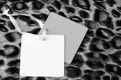 Etykietki na łaciastej tkaninie, moda projekta pojęcie Fotografia Stock