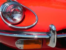 Etype Red. Detail of front of vintage sportscar Stock Image