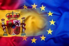 西班牙和欧盟挥动的旗子  EU旗子西班牙旗子 图库摄影