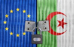 EU and Algeria flag on door with padlock. European business concept stock photo