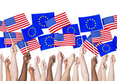 EU and American Flags. People holding EU and American flags stock photos