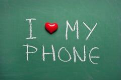 Eu amo meu telefone Fotografia de Stock Royalty Free