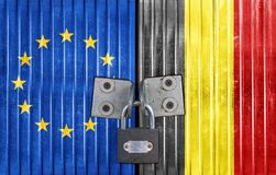 EU and Belgium flag on door with padlock. European concept door royalty free stock photos