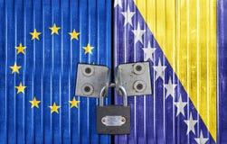 EU and Bosnia and Herzegovina flag on door with padlock. European door Stock Images
