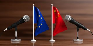 EU and China miniature flags. Cable microphones, wooden background, banner. 3d illustration Stock Photos