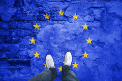 Eu cracked flag with a man Royalty Free Stock Photography