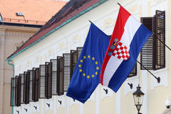 EU and Croatian flags together on Government building Stock Images