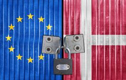 EU and Denmark flag on door with padlock. European gate Royalty Free Stock Photography