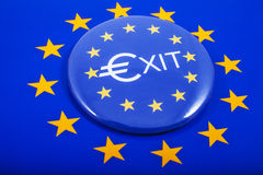 EU EXIT. An EXIT Pin Badge displayed over the European Union flag in reference to the upcoming referendum on Britain's membership to the European Union Stock Photos