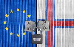 EU and Faroe Islands flag on door with padlock Stock Photo