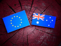 EU flag with Australian flag on a tree stump  Royalty Free Stock Photos