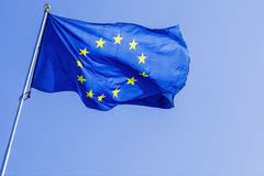 EU flag on a background of blue sky.  Royalty Free Stock Images