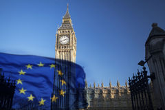 EU flag and Big Ben. European Union flag and Big Ben Clock Tower and Parliament house at city of Westminster in the background - UK votes to leave the EU, Brexit Royalty Free Stock Photo