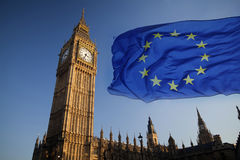 EU flag and Big Ben. European Union flag and Big Ben Clock Tower and Parliament house at city of Westminster in the background - UK votes to leave the EU, Brexit Royalty Free Stock Photos
