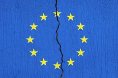 EU flag breaking apart , Cracked European Union flag royalty free stock photos