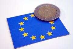 EU flag and coin. 2 Euro coin Stock Photography