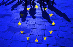 EU flag with crowd of walking people Stock Image