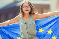 Free EU Flag. Cute Happy Girl With The Flag Of The European Union. Young Teenage Girl Waving With The European Union Flag In The City Royalty Free Stock Images - 97069449