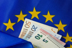 EU flag and Euro notes royalty free stock image