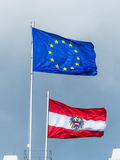Eu flag and flag austria. The european union (eu) flag and the austrian flag royalty free stock photo