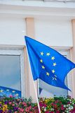 EU flag in France, waving. EU flag waving in front of a building on a pole royalty free stock image