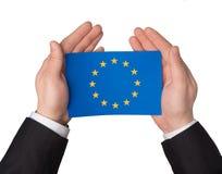 EU flag in hands Stock Photos