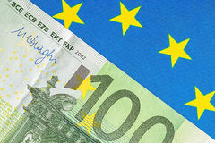 EU flag and many euro banknotes. Financial concept Royalty Free Stock Photo