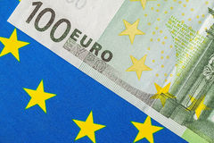 EU flag and many euro banknotes. Financial concept Stock Images