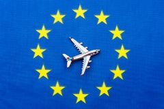 EU flag and the plane. The concept of travel. Toy airplane on the flag of the European Union Stock Photography