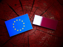 EU flag with Qatari flag on a tree stump isolated Royalty Free Stock Images